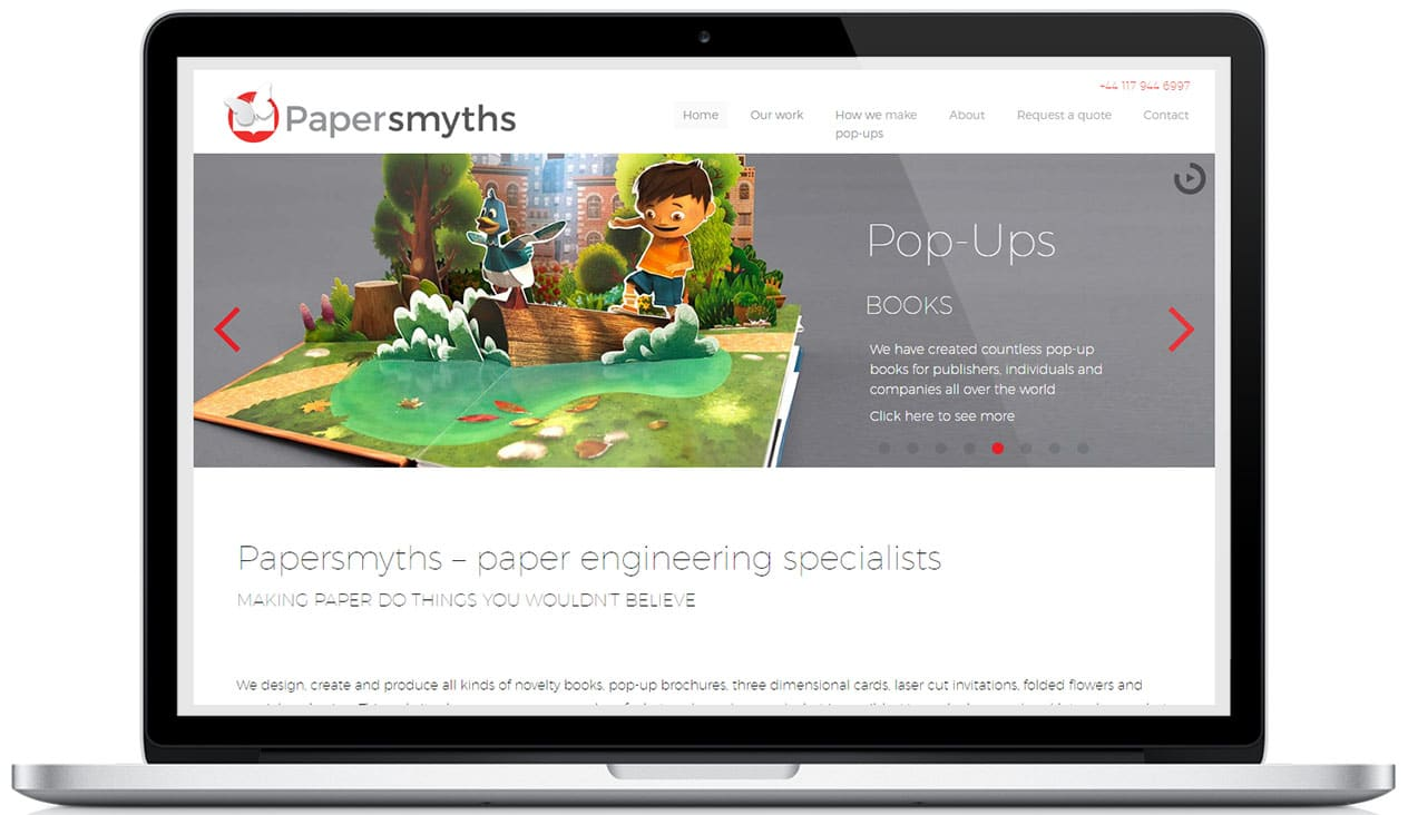 Papersmyths homepage hero image on a laptop
